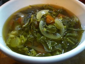 Greens soup with smoky molasses chilli broth