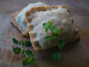 Caramelised onion and courgette pasties, with oregano, capers and garlic