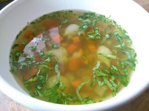 Carrot broth with basil and tiny onions
