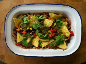 Nachos with green sauce and black bean salsa